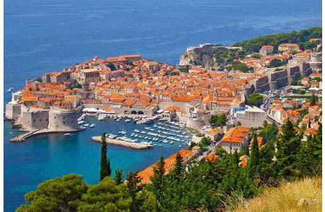Dubrovnik with its harbour and the historic town wall